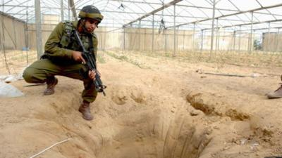 <p>An Israeli soldier pictured in 2006 at a tunnel uncovered during an Israeli counterterrorism operation designated to thwart weapons-smuggling from Egypt to Gaza.</p>