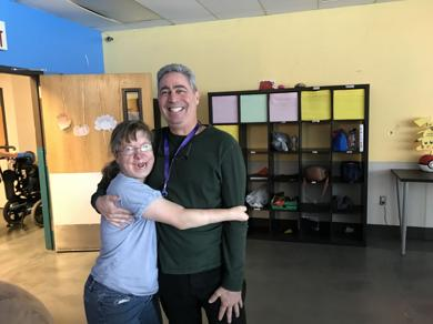 <p>Jeff Bernick, right, shares a warm moment with Shelly Lee, who participates in TCH's day program and lives in one of its group homes.</p>