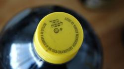 <p>A kosher-for-Passover bottle of Coca-Cola, distinguished from ordinary Coca-Cola bottles by its yellow cap.</p>