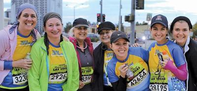 <p>The author, second from left, with fellow Team Lifeline Phoenicians, prepare to start their half-marathon down the Vegas strip last November.</p><p>Photo courtesy of Chai Lifeline</p>