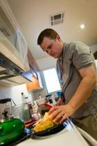 <p>A First Place Transition Academy student learns to cook at his apartment. The First Place Transition Academy, operated by Southwest Autism Research & Resource Center, is a two-year program designed to transition young adults with autism to living independently. The Sprouts Kitchen Network will offer cooking courses at First Place–Phoenix when it is completed in spring 2018.</p>