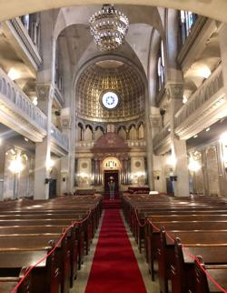 <p>A visitor stands in the sanctuary of Templo Libertad, Buenos Aires' first synagogue.</p>