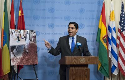 <p>Danny Danon, permanent representative of Israel to the United Nations, briefs journalists and shows picture of the July 21 attack in the settlement of Halamish that killed three Jewish family members.</p>
