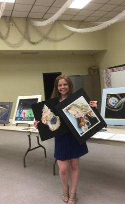<p>Gabby Loeff holds some of her artwork. Recently she was awarded a scholarship from the Scottsdale Artists League.</p>