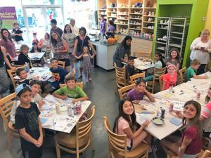 Kids make their mark, help raise money for synagogue's school