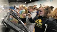 <p>Students in the zSpace mobile classroom utilize augmented reality technology to learn.</p>