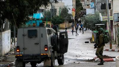 <p>Palestinians clash with Israeli soldiers in the West Bank city of Jenin on Jan. 18.</p>