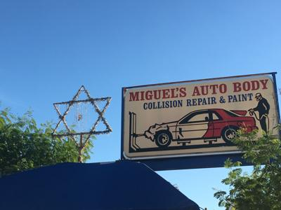 """<p class=""""p1"""">A large Star of David has been sitting atop Miguel's Auto Body's at 101 N. 16th St. for decades.<span class=""""Apple-converted-space""""></span></p>"""