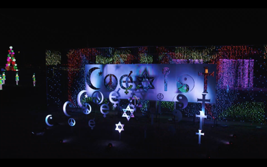 <p>One of the most popular stops at Illumination: Symphony of Light, is the large 'Coexist' display.</p>