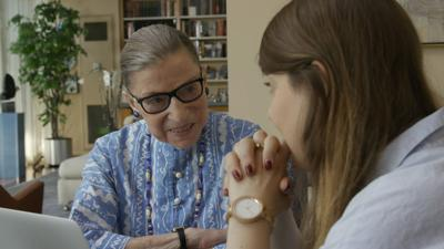 <p>Ruth Bader Ginsburg talks to her granddaughter in 'RGB.'</p>