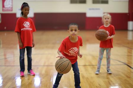 <p>Children play basketball as part of the Boys & Girls Club of Greater Scottsdale's summer programing.</p>
