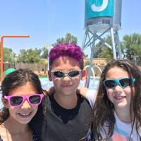 <p>From left, Hannah Venyige, Ryder Pietch and Mollie Ratterman celebrate National Sunglasses Day poolside at Shemesh Summer Camp at the Valley of the Sun JCC last summer.</p>