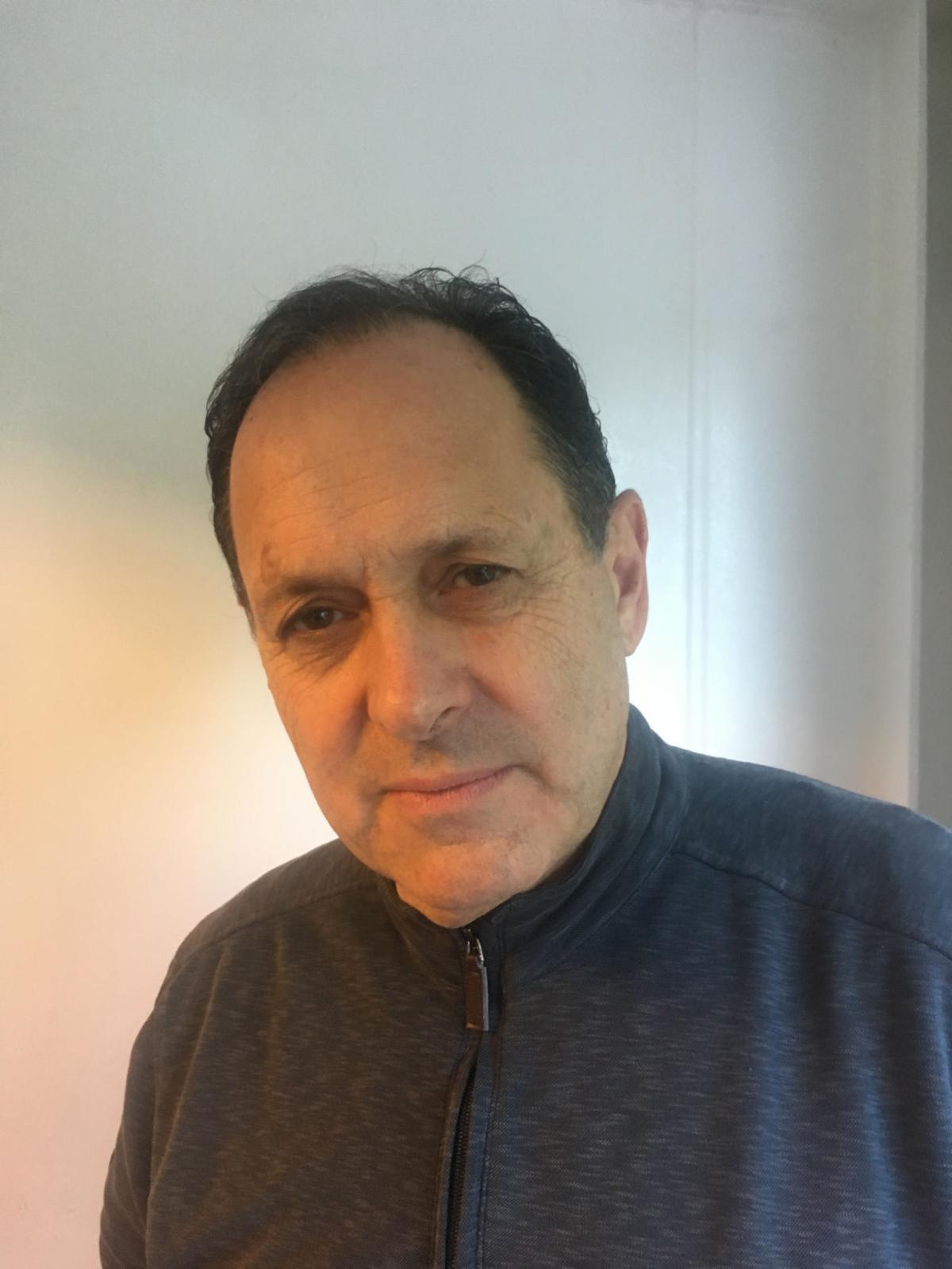 Dr. Raun D. Melmed