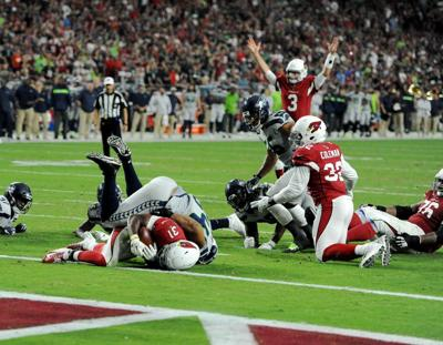 <p>Rosen, No. 3, celebrates a touchdown by Cardinals running back David Johnson against the Seahawks.</p>