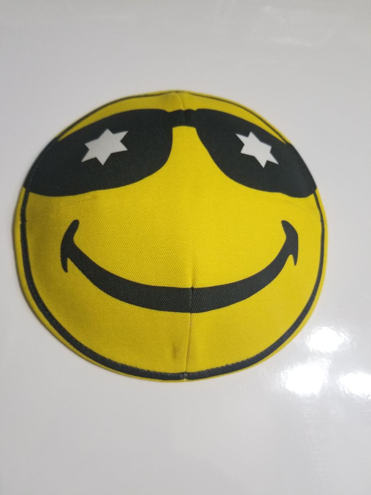 A newly designed emoji linen kippah from Judaica Central