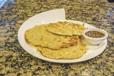 <p>Scallion pancakes can be served as discs or cut into wedges.</p>
