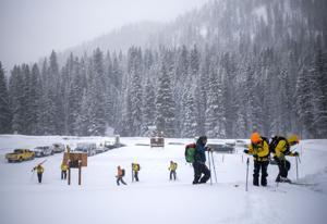 Buried snowboarder found, declared dead