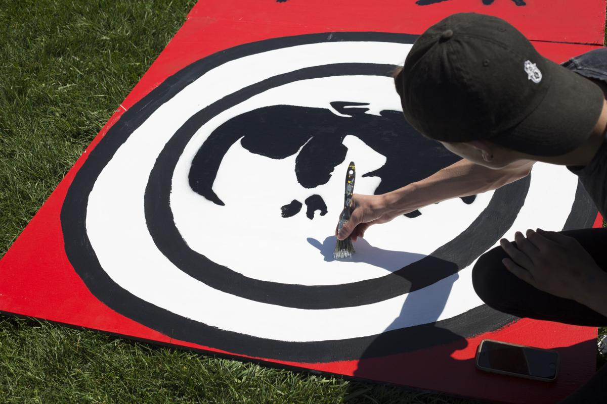 Students at Summit High School paint on canvases