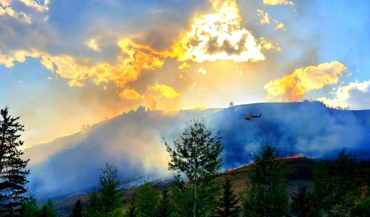 Sun sets on Saddle Butte Fire