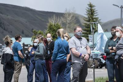 Healthcare workers gather for C-130 flyover