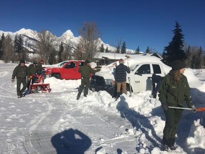 Workers dig out