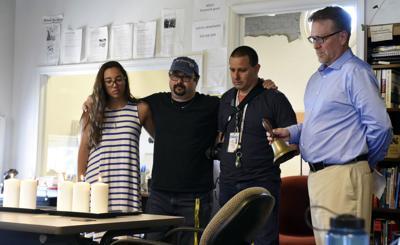 APTOPIX Shootings Newspaper Moment of Silence
