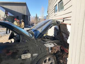 Truck hits house, opens gas leak