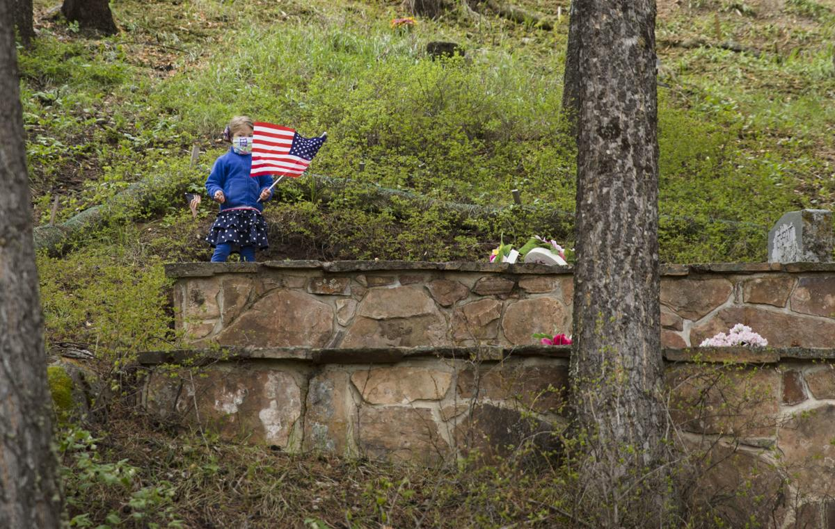 Veterans' graves decorated with flags in honor of Memorial Day