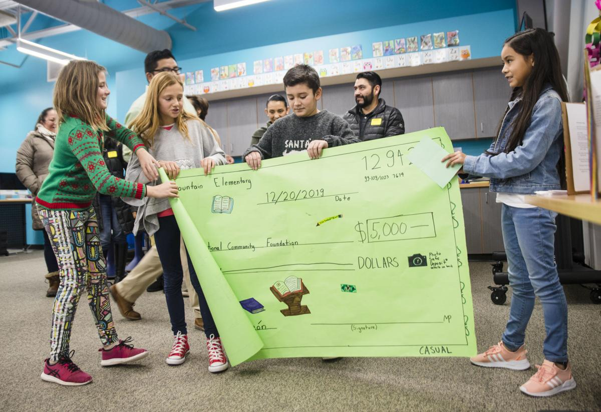 Munger Mountain students donate apple sale funds