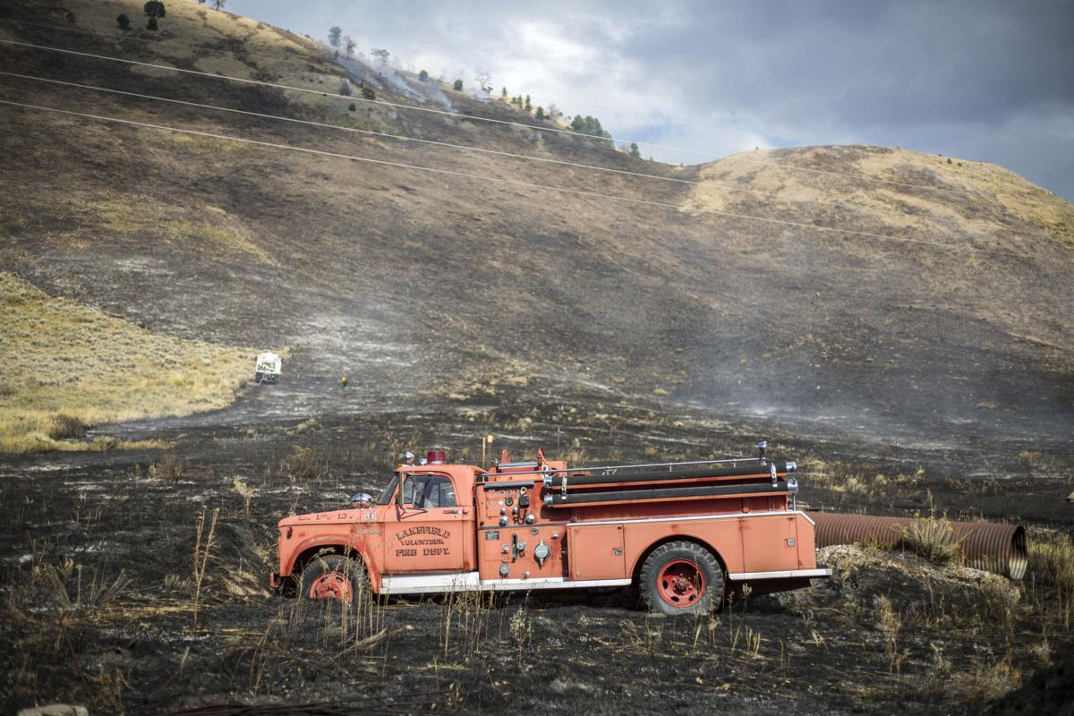 Firefighters jump on wildfire south of town
