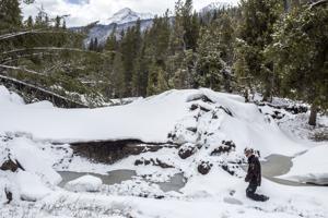 Alpine awaits runoff as slide dams muddy menace upriver