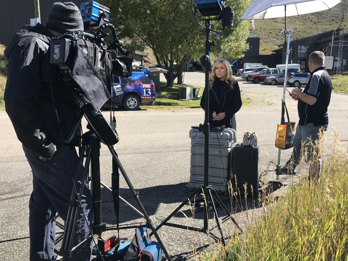 News crews set up outside Teton County coroner's office