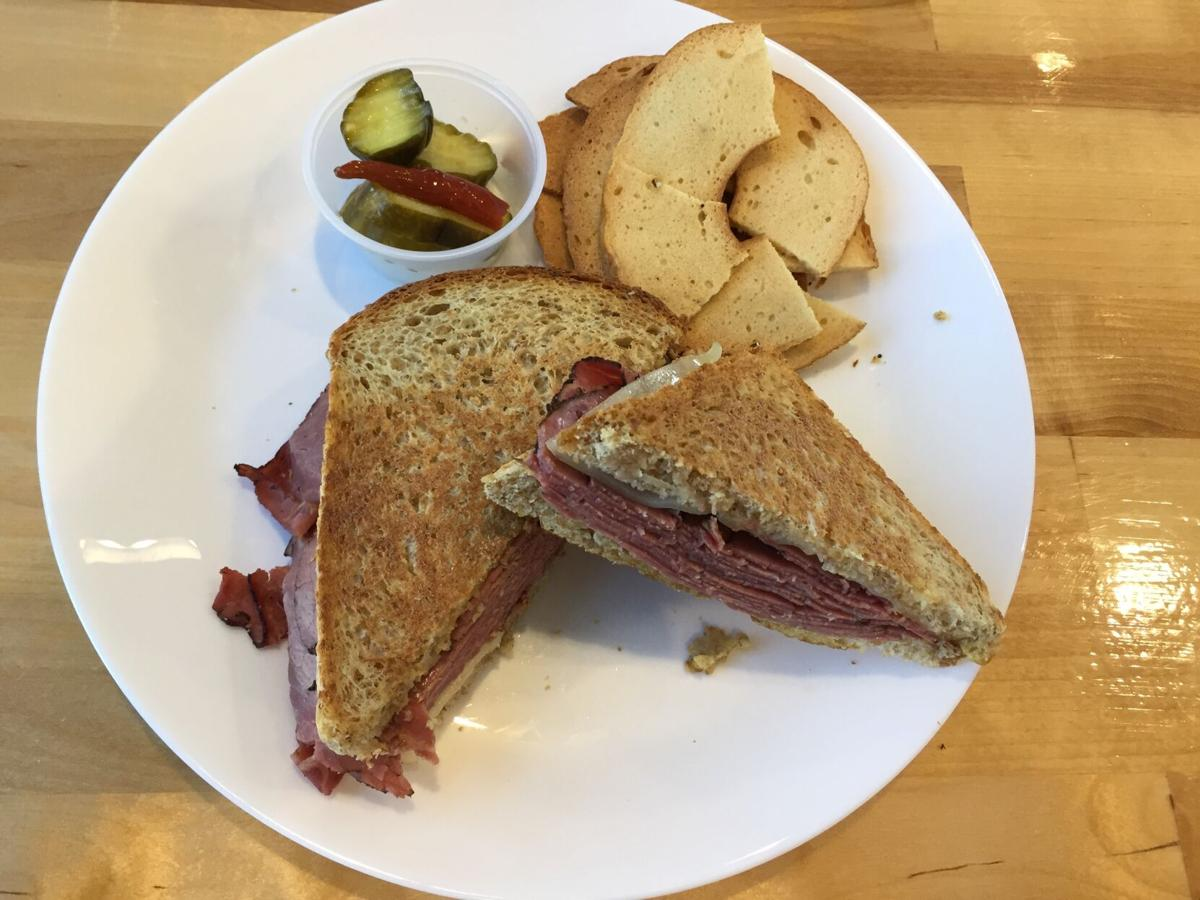 Crumb's pastrami on wheat with bagel chips, sweet pickles and spicy red peppers.JPG