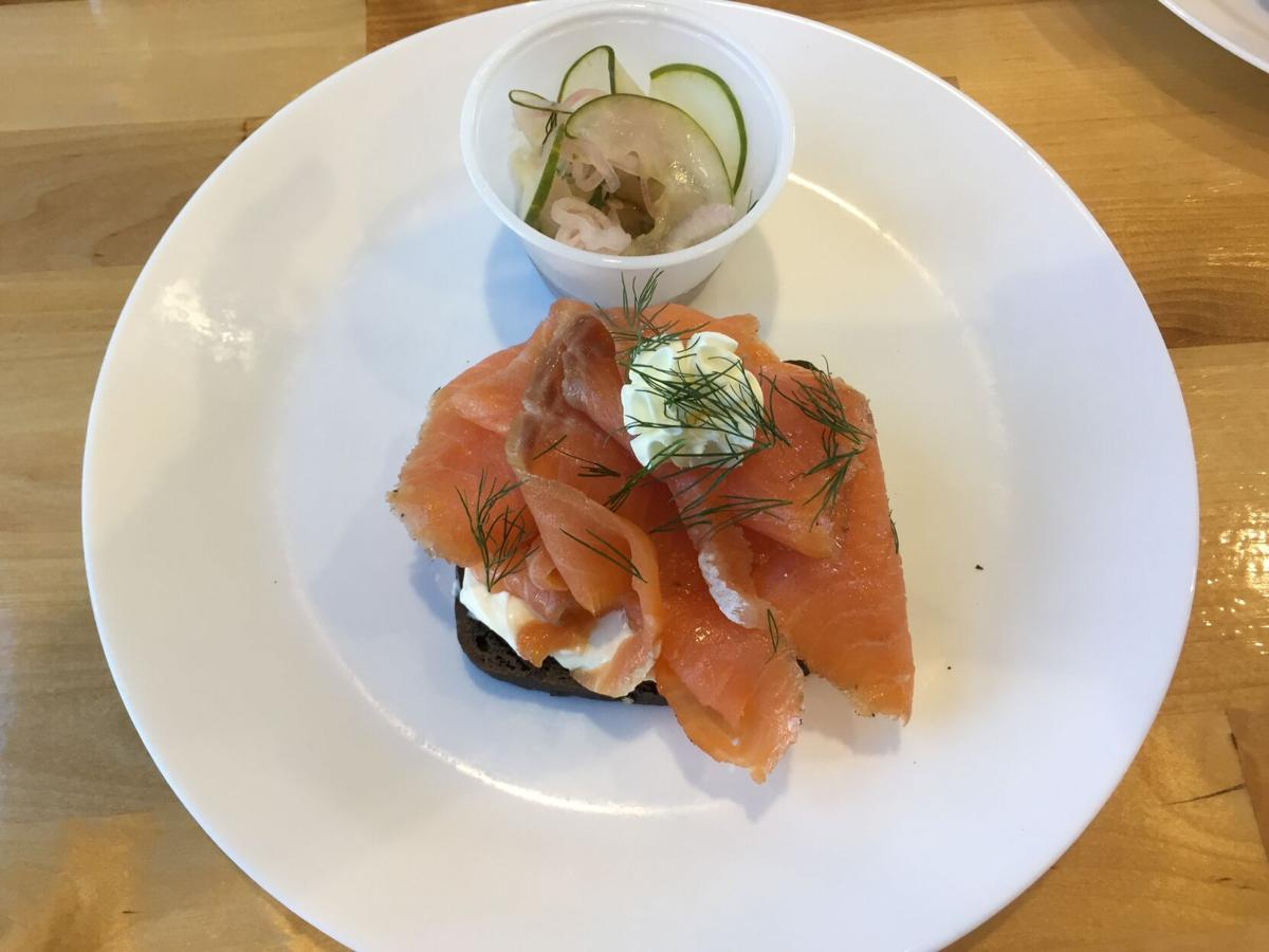 Crumb's Russian black bread with lox, cream cheese and dill, sided with pickled cucumber salad.JPG