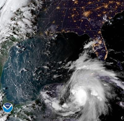 Michael strengthens into a hurricane, menaces Florida