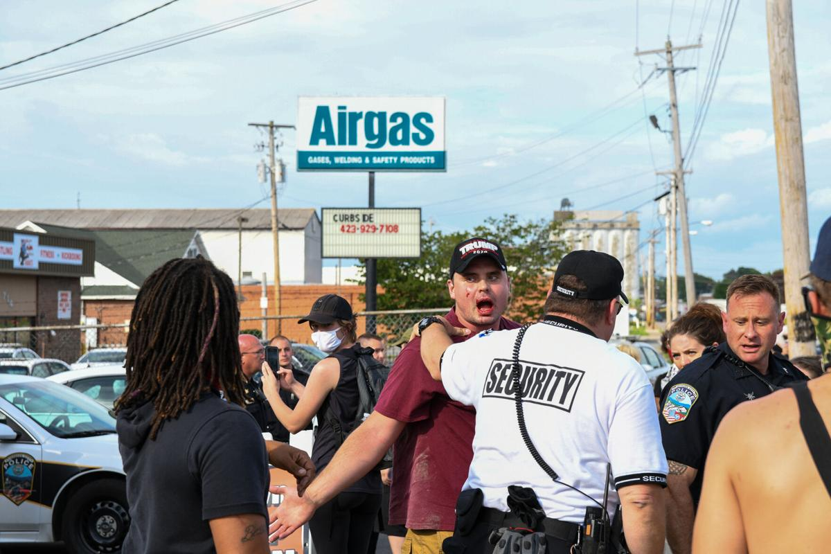 Tensions flare, protest erupts outside local pawn shop