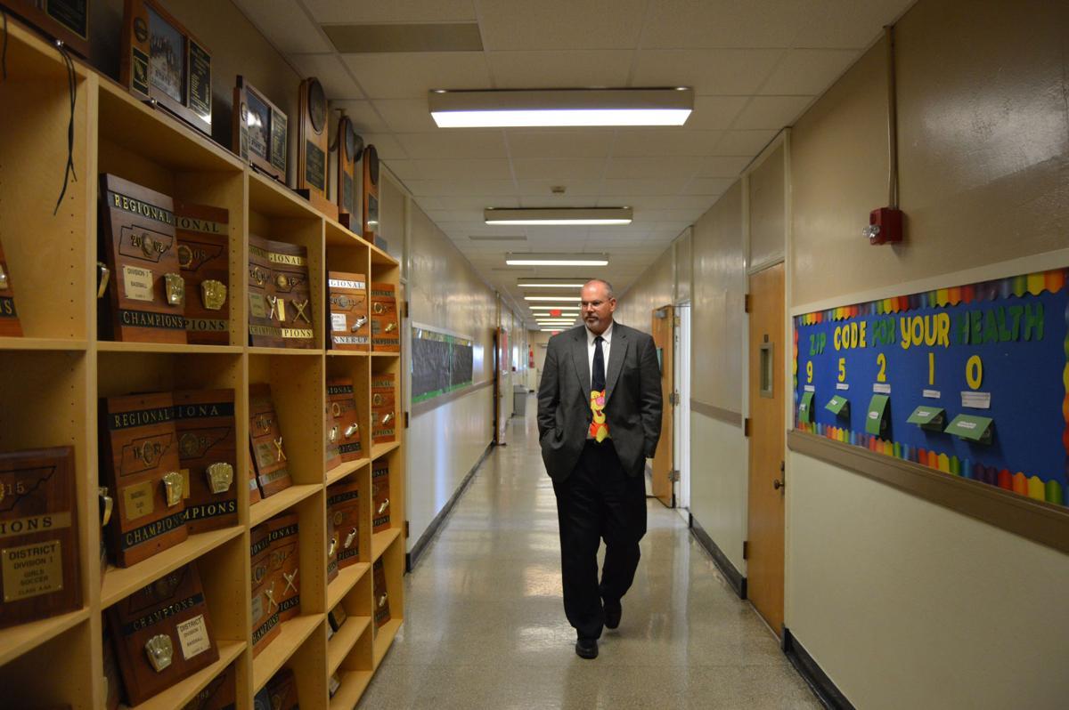 University School principal was a tall man with a big heart