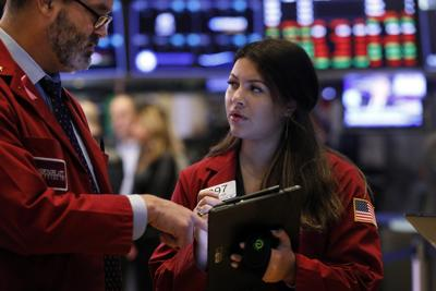 U.S. stocks cap wobbly day of trading with modest losses