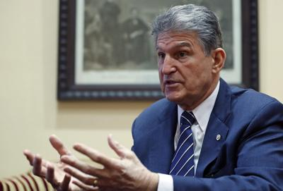 Senator Manchin 'at ease' with decision as others weigh in
