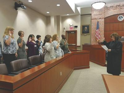 Nine new CASA advocates sworn in, commended