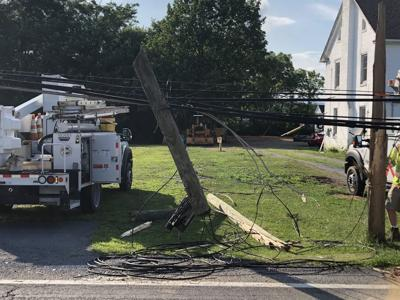 Dump truck takes out power lines in Inwood
