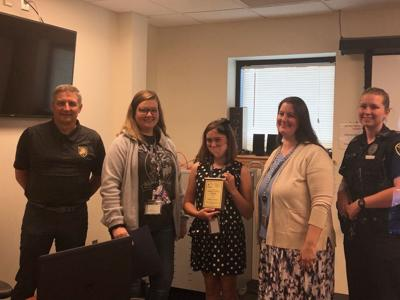 Communications Center recognizes lifesaving efforts of youth