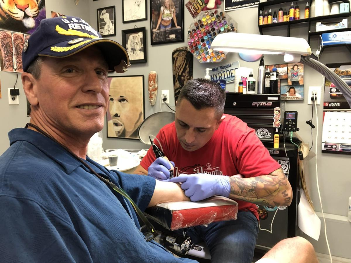 Man gets his first tattoo at age 60 to commemorate 42 years of Navy service