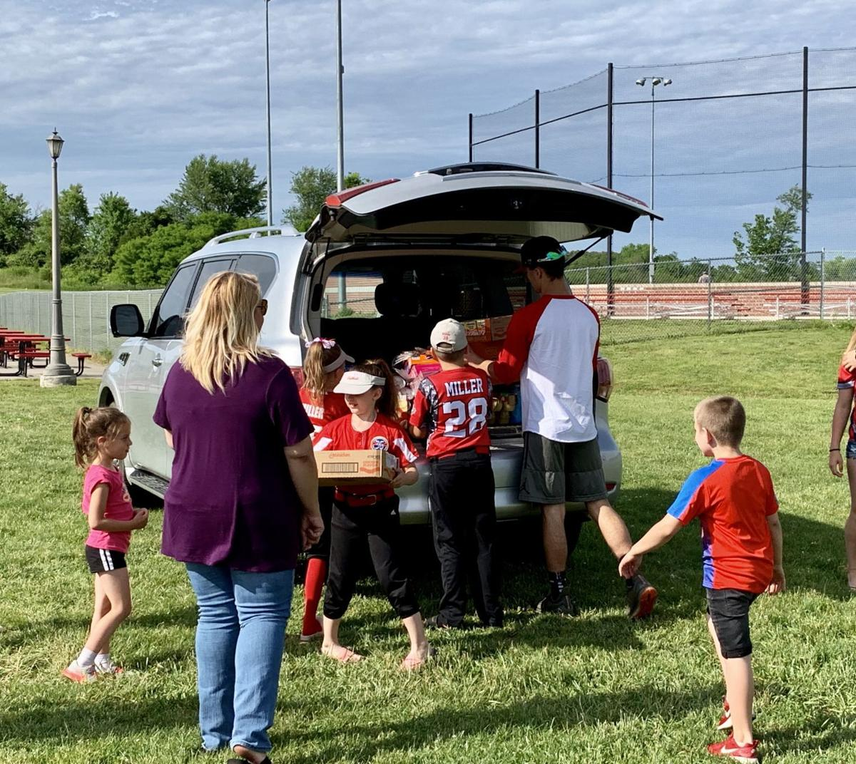 Local baseball, softball league fills trailer with food in an effort to give back to the community