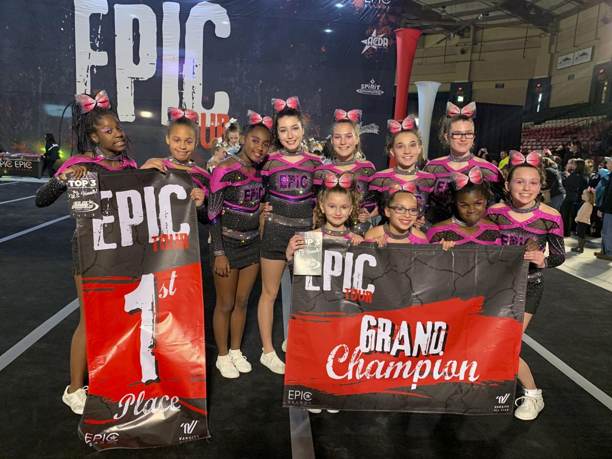reaching the summit epic daredevils earn invite to national cheer event