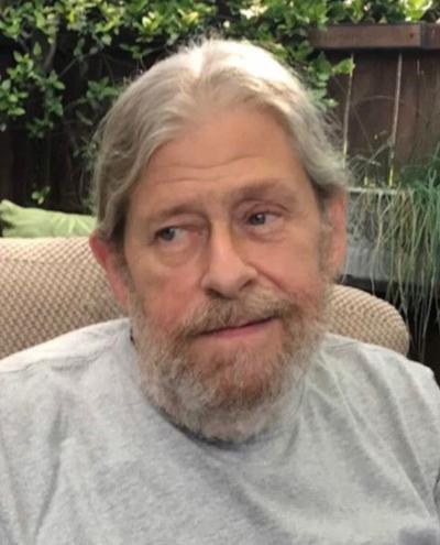 John E. Schimansky
