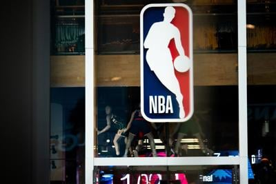 An NBA logo is shown at the 5th Avenue NBA store on March 12, 2020 in New York City.