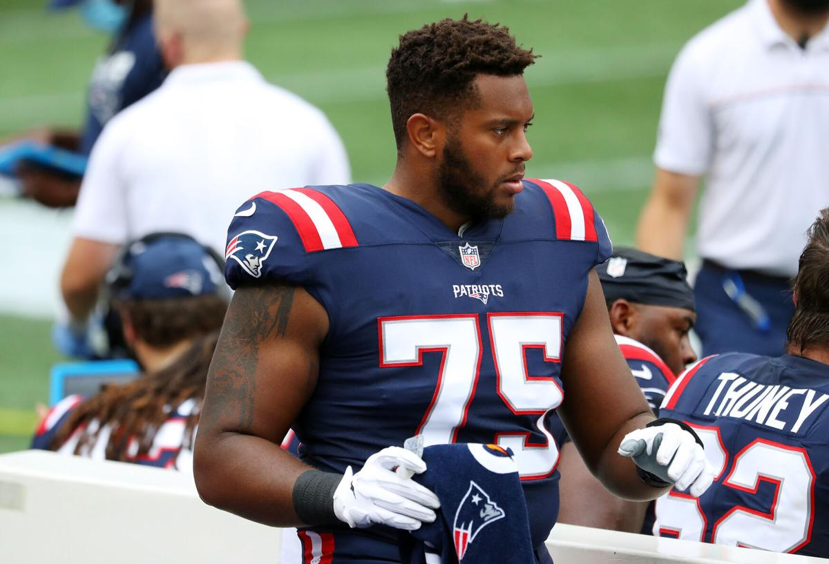 Justin Herron of the New England Patriots reacts on the sideline during the first half against the Las Vegas Raiders at Gillette Stadium on September 27, 2020 in Foxborough, Massachusetts.