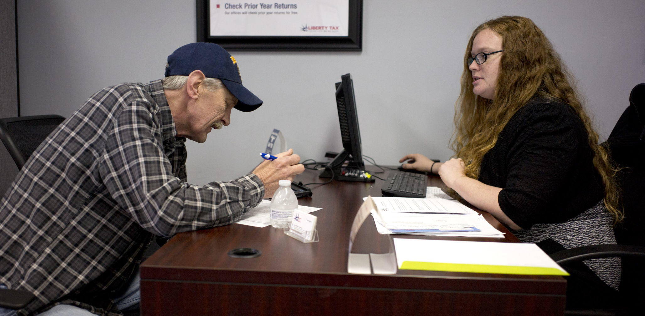 Even With An Extra Day, Last Minute Filers Converge On Tax Preparation  Offices