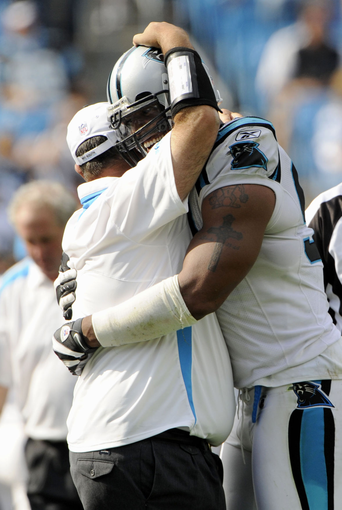 47958d465 Journal Photo by Bruce Chapman--09/28/08-- Carolina's Julius Peppers is  greeting by a member of the coaching staff during the 4th quarter at Bank  of America ...
